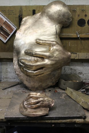 Raw bronze breasts in progress at foundry